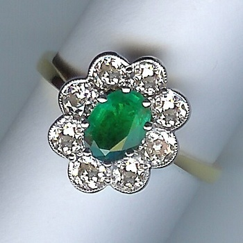 Enchanting Emerald and Diamond 9-Stone Cluster Ring