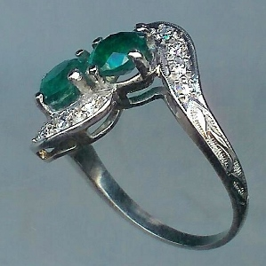 Evocative 2 Stone Emerald & Diamond Twist Ring