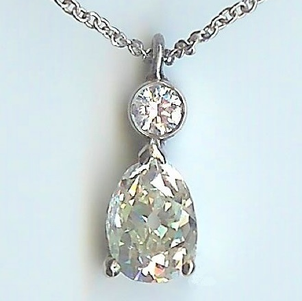 Spine-Tingling 2 Stone Diamond Pendant & Chain